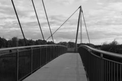 Closer view on a pedestrian bridge in black and white in meppen emsland germany. Photographed during a sightseeing tour in meppen emsland germany royalty free stock photo