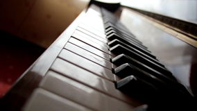 Closer view of the piano keys stock video footage