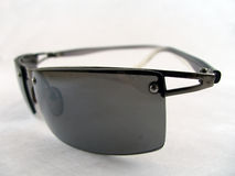 Closer view of sunglasses. Close image of sunglasses with metalic frame Royalty Free Stock Photography