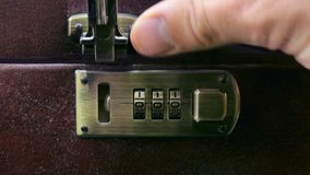 Closes the case with combination lock. 4k stock video footage