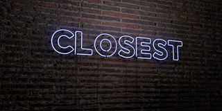 CLOSEST -Realistic Neon Sign on Brick Wall background - 3D rendered royalty free stock image Stock Image