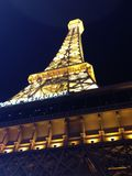 Closest thing to Paris. Nightlife shining under the Eiffel royalty free stock photo