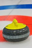 Closest to the pin. Rock draws to the button on the curling ice Stock Images