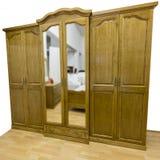 Closet. Classic closet made of masive oak wood, placed on laminate floor. on white royalty free stock photo