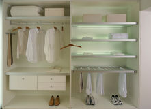 Closet. Modern dressing room with clothes and shoes stock photo
