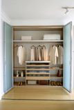 Closet. Clothes organized in modern closet royalty free stock image
