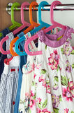 Closet with baby dresses Royalty Free Stock Photo
