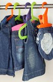 Closet with baby dresses on hangers Stock Images