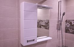 Closet in the bathroom. Shelf with a mirror in the bathroom.  Details stock photo