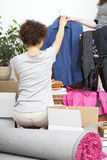 Closet clean up. A woman doing a clean up in her fashion closet royalty free stock photo