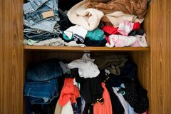 Closet with clothes royalty free stock photography