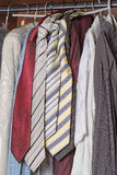 Closet of clothes for men. Inside of a closet with men's clothes royalty free stock images