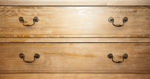 Closet handles. Bronze handles on retro wood closet stock photography