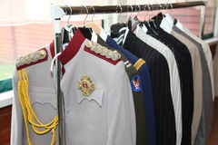 Closet. hanger with mens suits, tuxedos, jackets officer for carnival themed party Stock Image