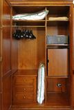 Closet in hotel. Hotel closet with safety box and small fridge royalty free stock photo