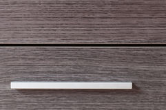 Closet metalic handle and wooden doors Royalty Free Stock Photos
