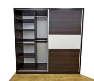 Closet with open door. Modern closet with two sliding doors, made of laminated chipboard. One door is open in order to show interior of the closet stock photos