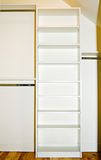 Closet organizer space. A small closet interior showing the organizer shelving and rods. (A blank canvas for designers Royalty Free Stock Photos
