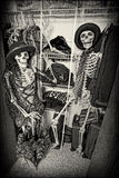 Closet Skeletons. Two skeletons enjoying themselves in someone's closet. Grain intended stock images