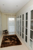Closet - White Dressing Room - Luxury Home. White dressing room with doors on the sides stock image