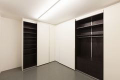 Free Closet With Open Doors Royalty Free Stock Photos - 104412868