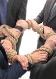 closeup группа в составе бизнесмены держа руки Стоковая Фотография RF