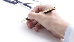 closeup рука доктора писать рецепт Стоковые Изображения