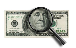 Closeup of a $100 banknote -through the magnifier Royalty Free Stock Images