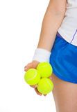 Closeup on 3 tennis balls in hand of tennis player Royalty Free Stock Photography