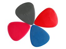 Closeup of 4 colourful plectrums Royalty Free Stock Photo