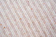 Closeup of 50% wool carpet with stripes. A close up image of a carpet made of 50 % wool and 50% polypropylene with stripes Royalty Free Stock Photo