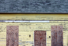 Closeup of Abandoned Yellow House Stock Photo
