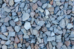 Closeup of an abstract background made of stones. A variety of stones with differing shades of bluish color Royalty Free Stock Photography