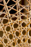 Closeup Abstract of Patterns and Wicker Weave on Chair Stock Image