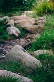 Closeup abstract of rocks on a walking hiking trekking path up i Stock Photo