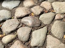Closeup of abstract weathered cobblestones. Closeup of abstract textured background of weathered cobblestones Royalty Free Stock Image