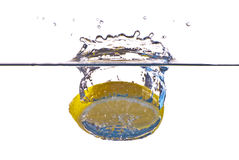 Closeup abstract yellow lemon splashing in water Royalty Free Stock Photos