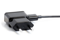 Closeup of an AC power adapter plug Royalty Free Stock Image