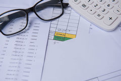 Closeup accounts number on a printed paper ,Calculator and glasses. Stock Image