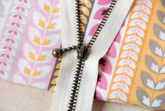 A cream zipper on fabric. Closeup of acream zipper on sweet fabric royalty free stock image