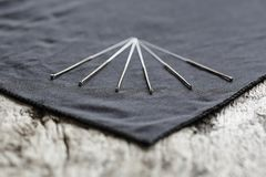 Closeup of Acupuncture needles on a wooden table. A Closeup of various Acupuncture needles with depth of field stock image