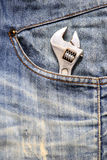 Closeup of an adjustable wrench in a jean pocket Stock Photography