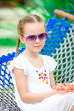 Closeup adorable little girl relaxing in hammock on tropical vacation Stock Photo