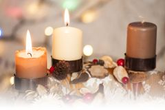 Closeup of Advent wreath with two burning candle and Christmas lights in background. Closeup of Advent wreath with two burning candle and white background with stock photos