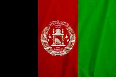 Flag of Afghanistan. Closeup Afghanistan national flag background, with fabric texture Stock Images