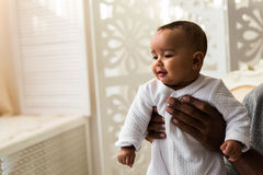Closeup of African American curious baby boy looking away.  Stock Photo