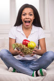 Closeup African AMerican woman with fruits. Beautiful african woman looking into camera and smiling Royalty Free Stock Photography