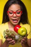 Closeup African AMerican woman with fruits. Royalty Free Stock Photo