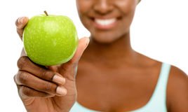 Closeup African AMerican woman holding green apple white backgro. African American woman holding green apple Stock Photography