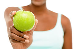 Closeup African AMerican woman holding green apple white background Stock Images